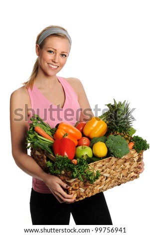 Smiling young woman with fruits and vegetables. Isolated on white - stock photo