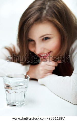 Smiling Young Woman with glass of Water - stock photo