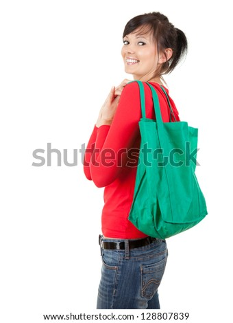 smiling young woman with green ecological shopping bag, white background - stock photo