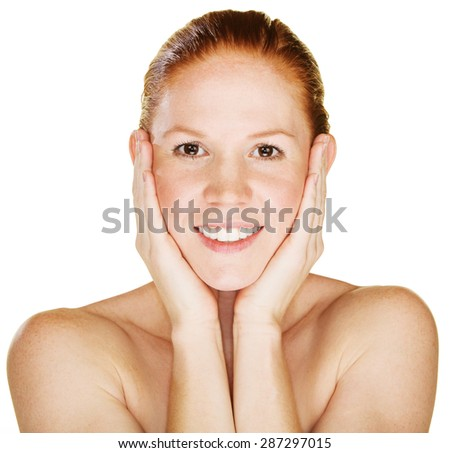 Smiling young woman with hands on face - stock photo