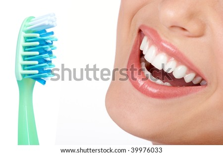 Smiling  young woman with healthy teeth and a tooth-brush - stock photo