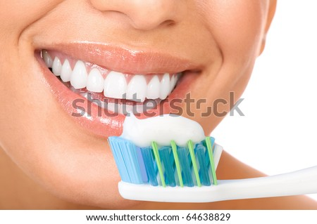 Smiling  young woman with healthy teeth holding a tooth-brush - stock photo