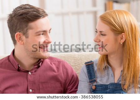 Smiling young woman with her hearing impairment man - stock photo