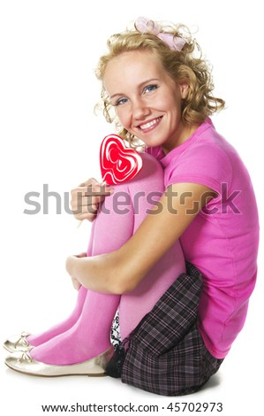 smiling young woman with lollipop - stock photo