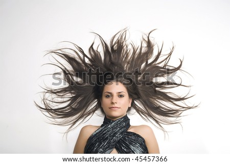 Smiling young woman with magnificent scattered hair - stock photo