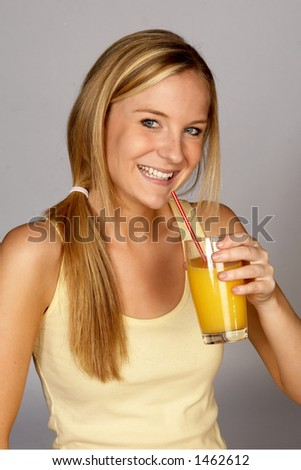 Smiling Young Woman with Orange Juice - stock photo