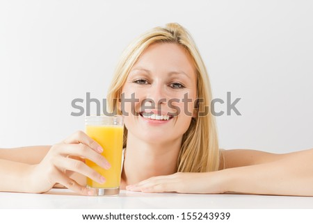 Smiling young woman with orange juice. - stock photo