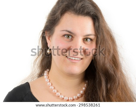 smiling young woman with pearls - stock photo