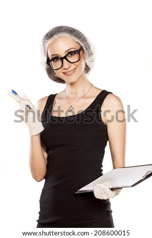 smiling young woman with pen, protective cap and gloves - stock photo