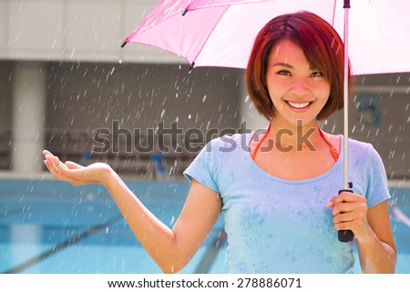 smiling young woman with rain - stock photo