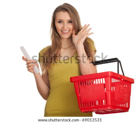 smiling young woman with red basket with purchases list, waving hello - stock photo