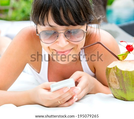 Smiling young woman with telephone - stock photo