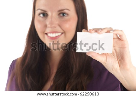Smiling young woman with white blank card (focus on hand) (isolated) - stock photo