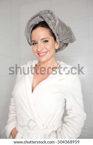 Smiling Young Woman Wrapped with Towels After Bath