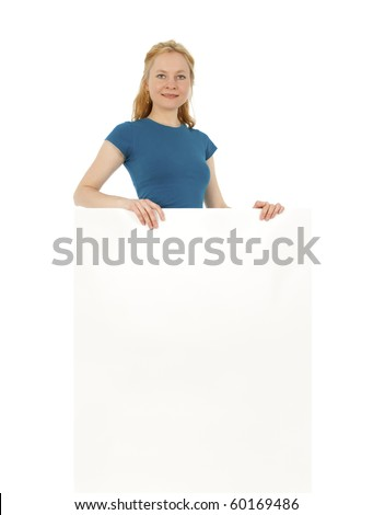 Smiling young women behind a blank banner ad, isolated on white. - stock photo