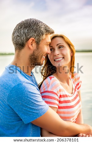 smiling younger parents happy laughing together - stock photo