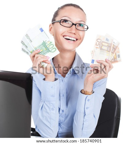 Smilling businesswoman on workplace with euros in hands