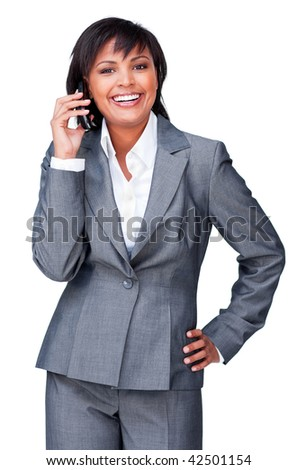 Smilling hispanic businesswoman on phone against a white background - stock photo