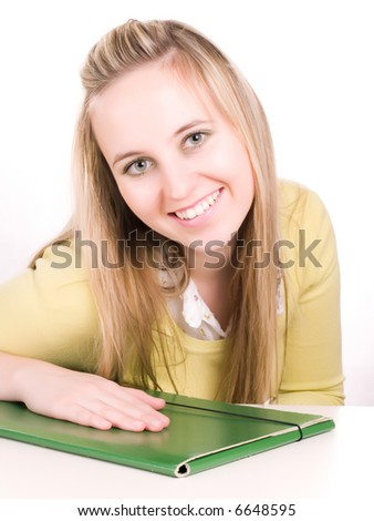 smilling student with green folder