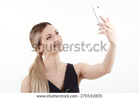 Smilling woman with a phone - stock photo