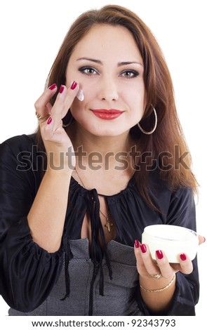 Smilling woman with face cream isolated on white - stock photo