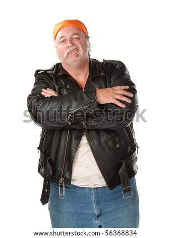 Smirking biker gang member with leather jacket - stock photo
