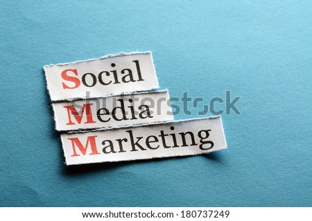 SMM - Social Media Marketing on blue paper - stock photo