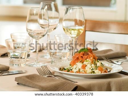 Smocked salmon and potato salad in stylish dinner setting - stock photo