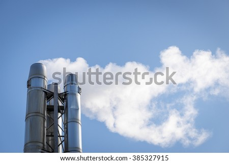 Smog coming out from chimney - stock photo