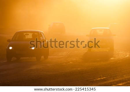 Smog from forest fires on the road. - stock photo