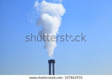 Smoke against blue sky (Center) - stock photo