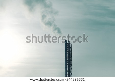 Smoke and pipes plant, environmental problems - stock photo