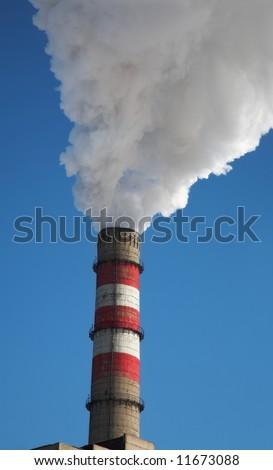 Smoke billowing from tall stacks - stock photo
