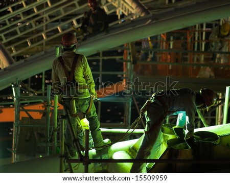 Smoke Break during late night work at a large construction project - stock photo