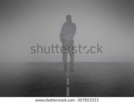 Smoke. Businessman goes into the mist