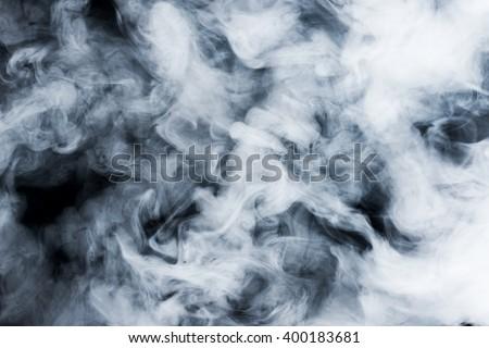 smoke clouds on dark background - stock photo