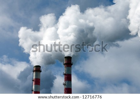 Smoke coming out of an industrial pipes - stock photo