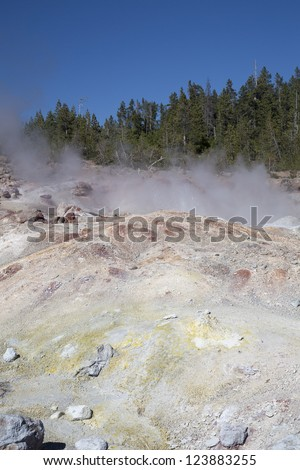 Smoke coming out of  hot springs and geysers  in Yellowstone National Park, Montana, Wyoming, USA - stock photo