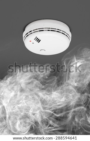 smoke detector of fire alarm in action - stock photo