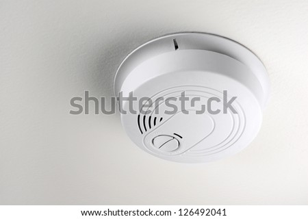 smoke detector on a ceiling - stock photo