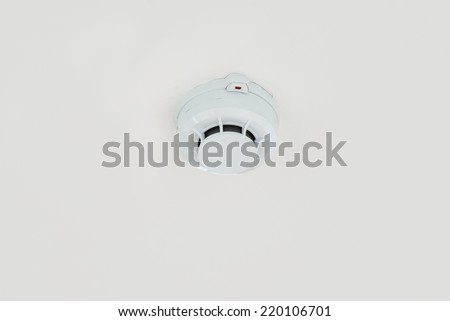 Smoke detector on ceiling. - stock photo