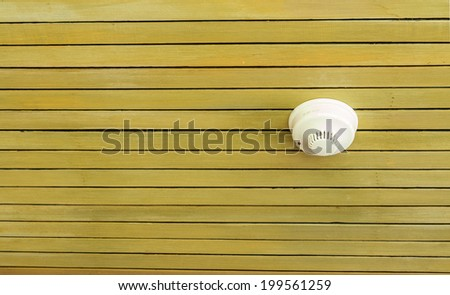 Smoke detector on ceiling wooden in resort or spa. it look good to use protect . - stock photo