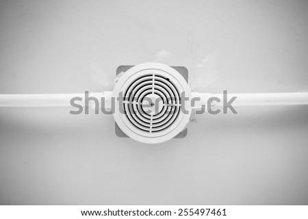 Smoke detector sensor on cement ceiling in black-white tone - stock photo