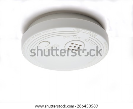 Smoke detector with alarm for fire safety - stock photo