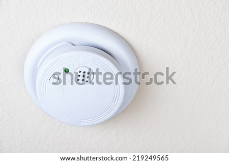 Smoke fire alarm on the ceiling - stock photo