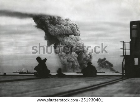 Smoke from a merchant ship bombed in an Allied convoy to the Soviet Union (Russia).October 1942. - stock photo