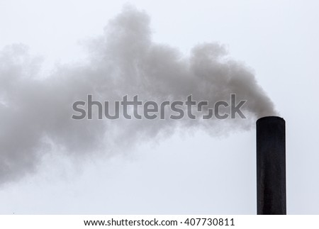 Smoke from a pipe on a cloudy sky
