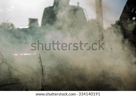 Smoke from burning trash.