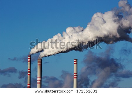 smoke from  chimneys of coal power plant - stock photo