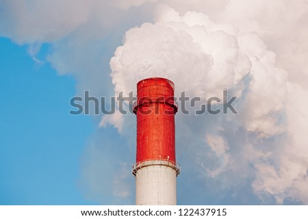 Smoke from factory pipe - stock photo